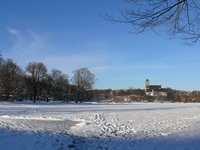 Frozen Schlossteich lake with the Schlosskirche in the background