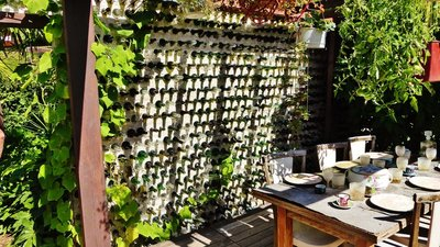 Wall of wine bottles at one garden in the Festival