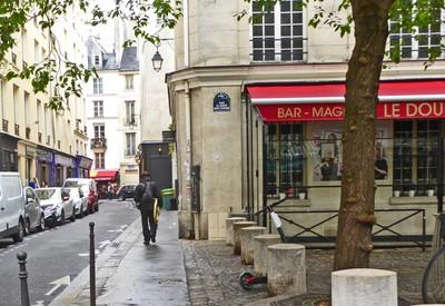 A lonely tuba player passing through Place du Marché Sainte-Catherine