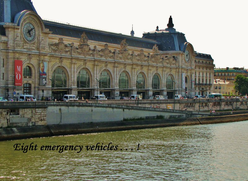 8 emergency vehicles lined up in front of the Musée d'Orsay