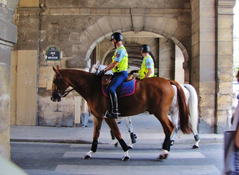 Police horseback patrol on rue de Birague leaving Place des Vosges