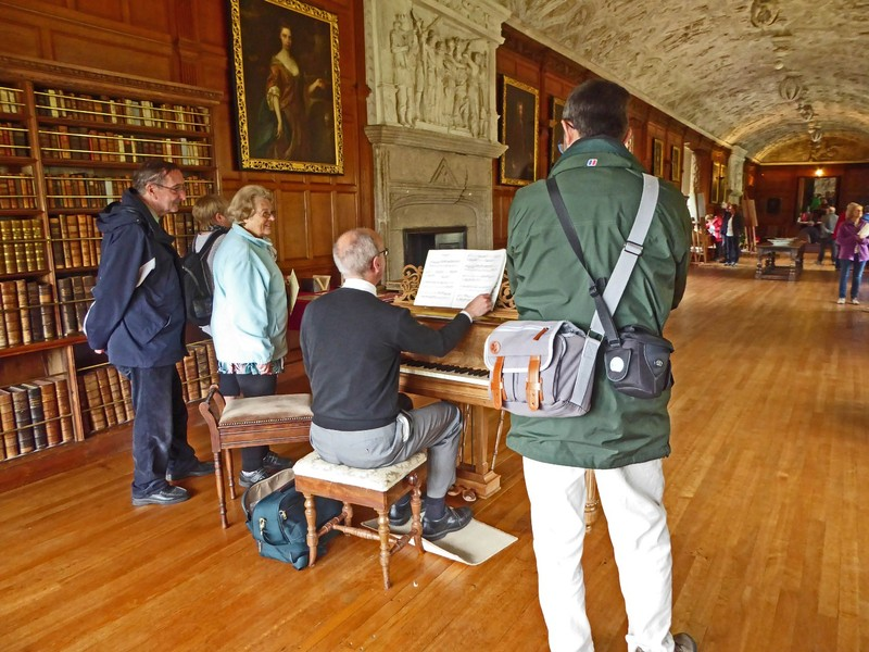 Pianist in the library of Lanhydrock House