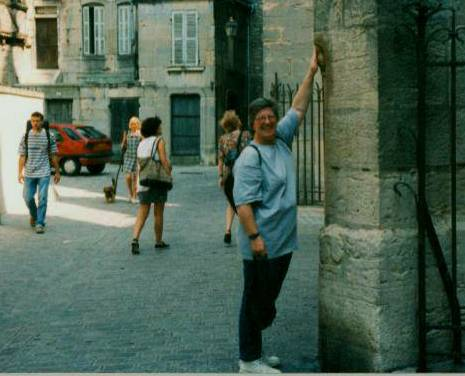 Rubbing the owl (chouette) on Eglise Notre Dame in Dijon