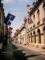 Rue de la Liberté with flags flying