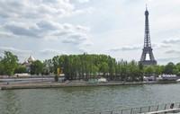 Eiffel Tower on the right and Cathédrale de la Sainte-Trinité on the left