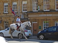 Riding past Lloyds Bank in Chipping Campden