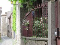 Metal gate and street in Old Town Lagrasse