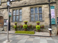 Floral Display of Saint Cuthbert's Cross in front of Durham University Library