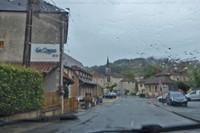 Driving through Le Bugue in the rain