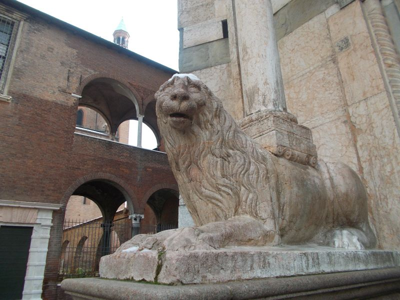 Snow capped lion outside the baptistry. - Cremona