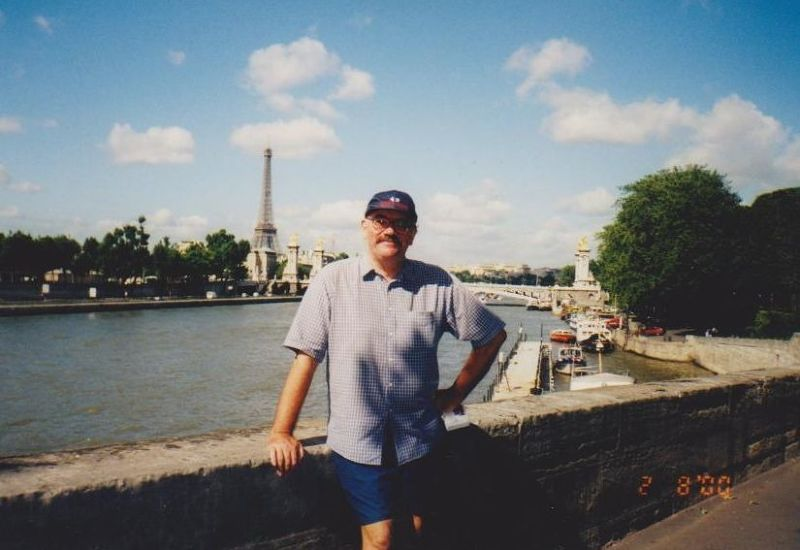 My husband with the Eiffel Tower. - Paris