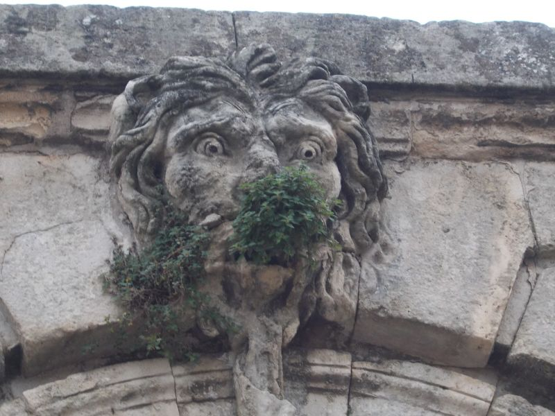 Carved face at The Promenade du Peyrou. - Montpellier