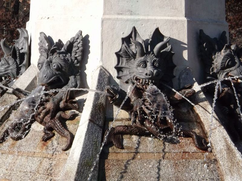 Monsters on angel fountain. - Madrid