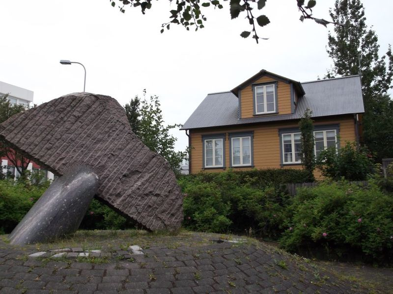 Interesting Sculpture And House.