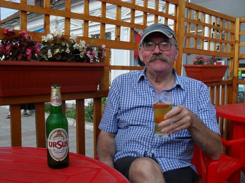 My husband enjoying a beer in Rasnov - Rasnov