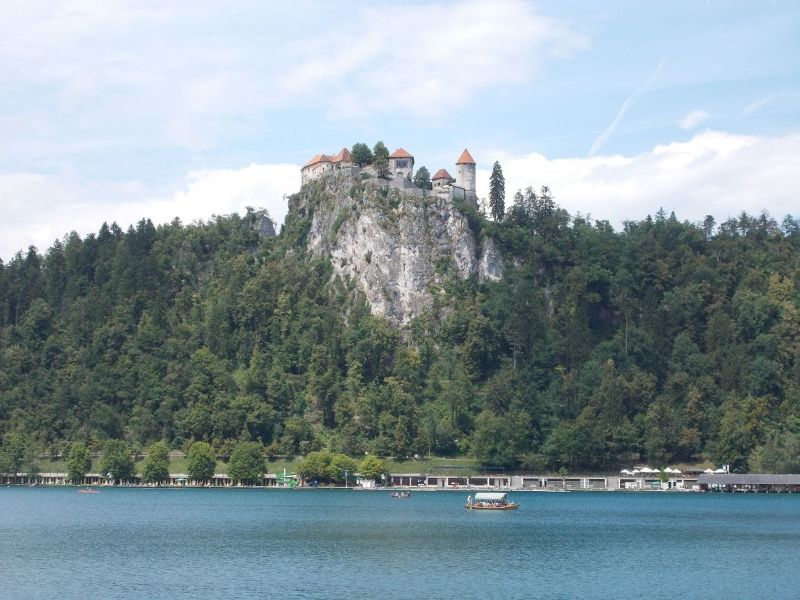 Bled Castle looming over Lake Bled. - Bled