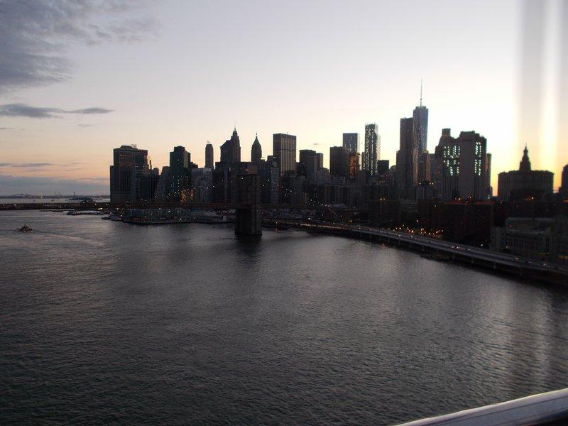 Darkness descends over Manhattan.
