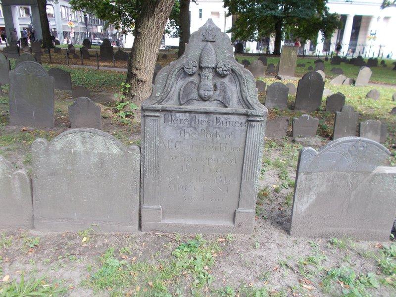 Cherub head gravestone.