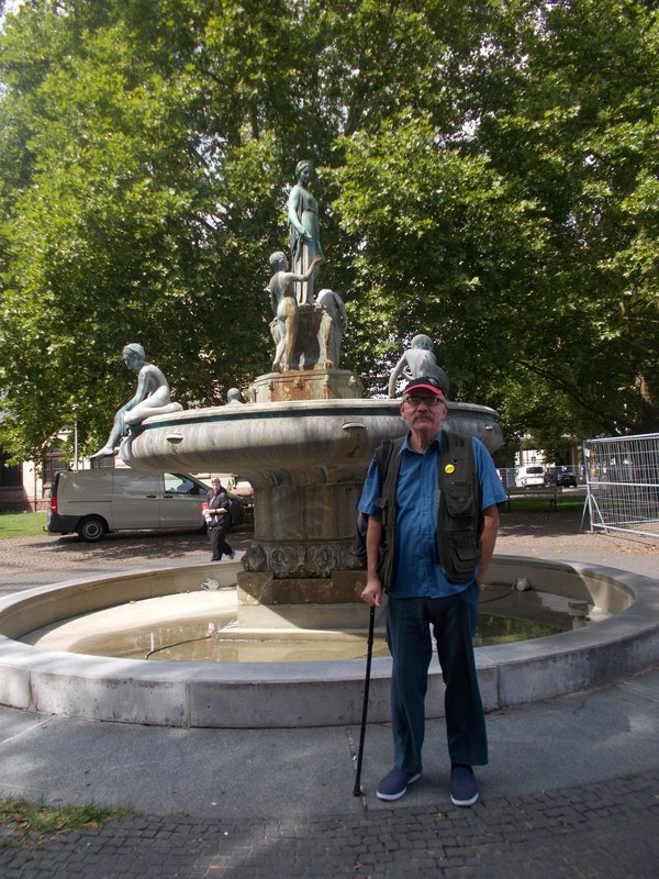 Peter in front of the fountain.