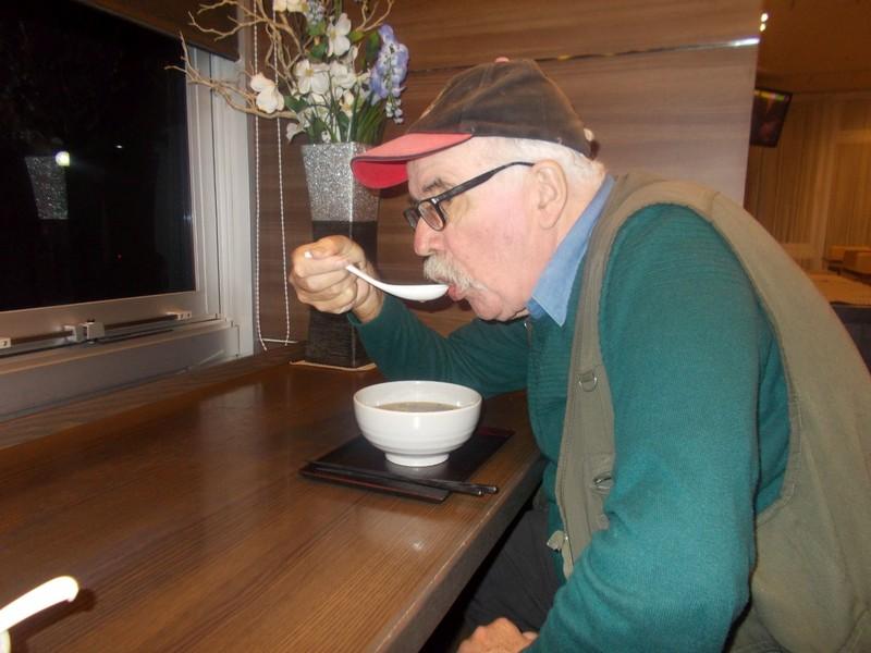 Enjoying a bowl of noodles.