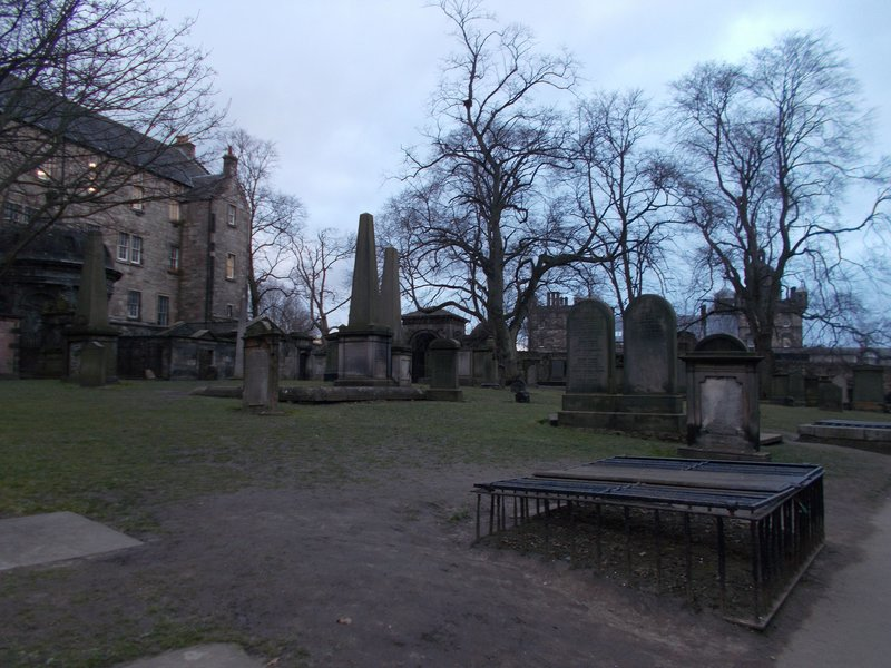 In the kirkyard, graves protected from bodysnatchers..
