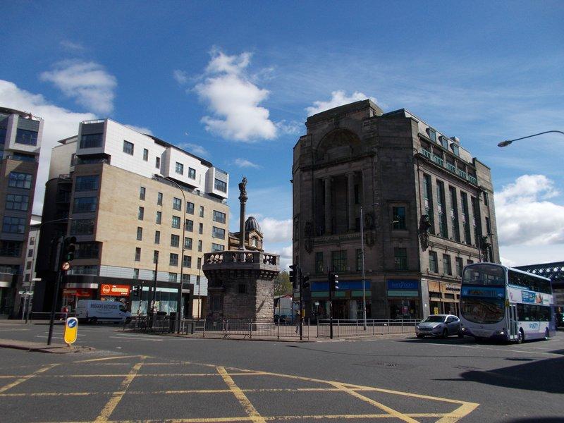Mercat Cross and the Mercat Building.