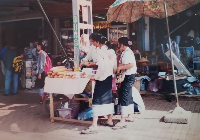 School girls buying bread.
