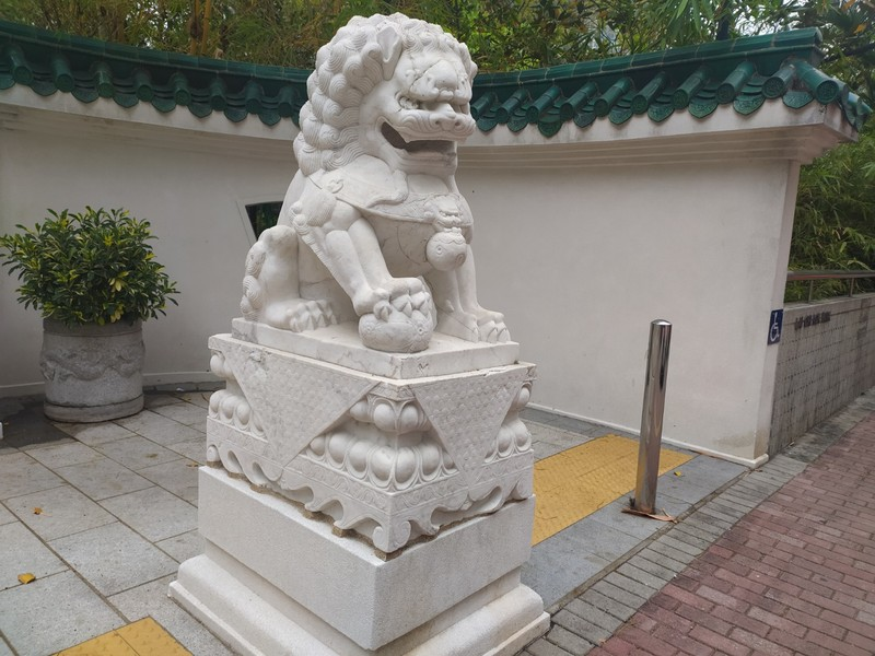 Lion guarding the park gateway.
