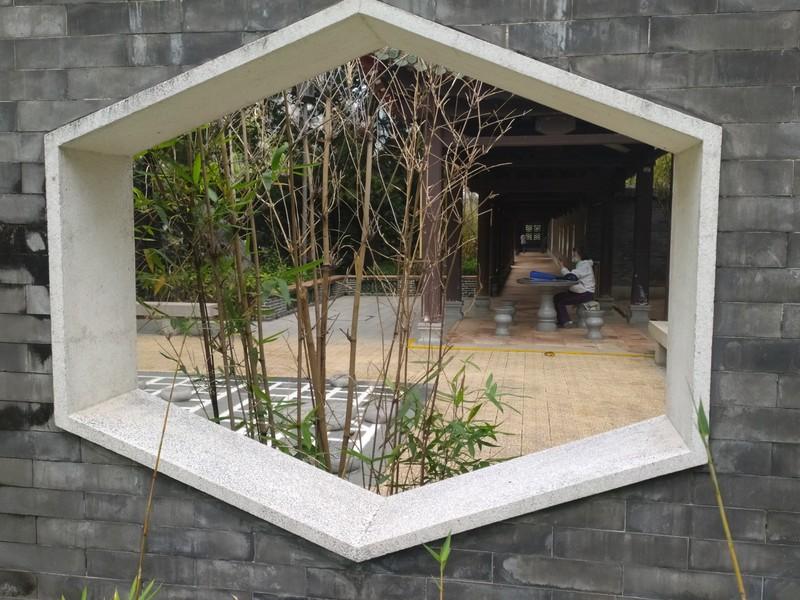 Through the hexagonal doorway.