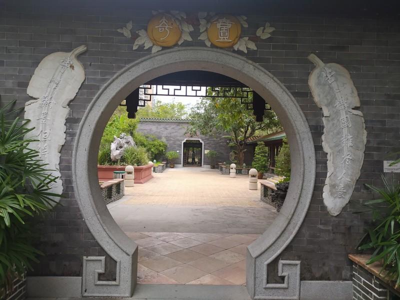 Through the round doorway.
