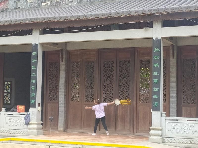 Tai Chi with a tambourine.