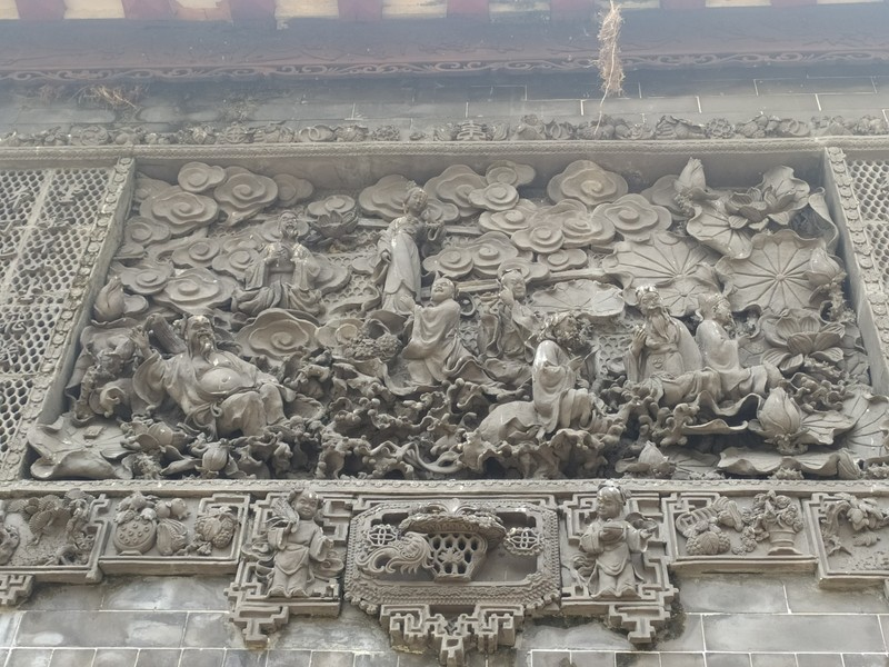 Carvings on entrance to Lingnan Gardens.