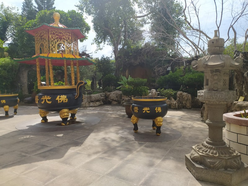 Incense and stone lanterns outside the monastery.