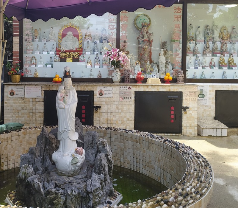 At the shrine of the four faced Buddha.