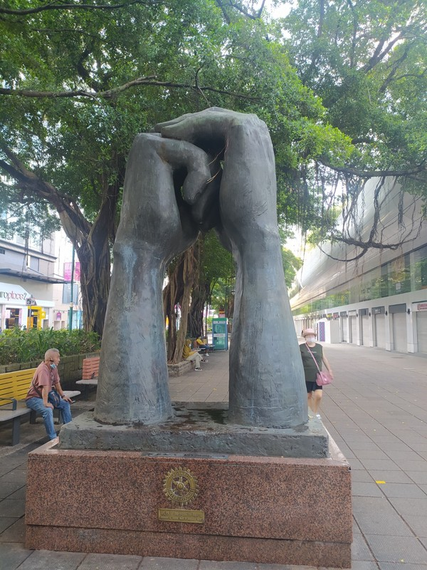 This statue is entitled 'Please' and it's by sculptor, Van Lau.