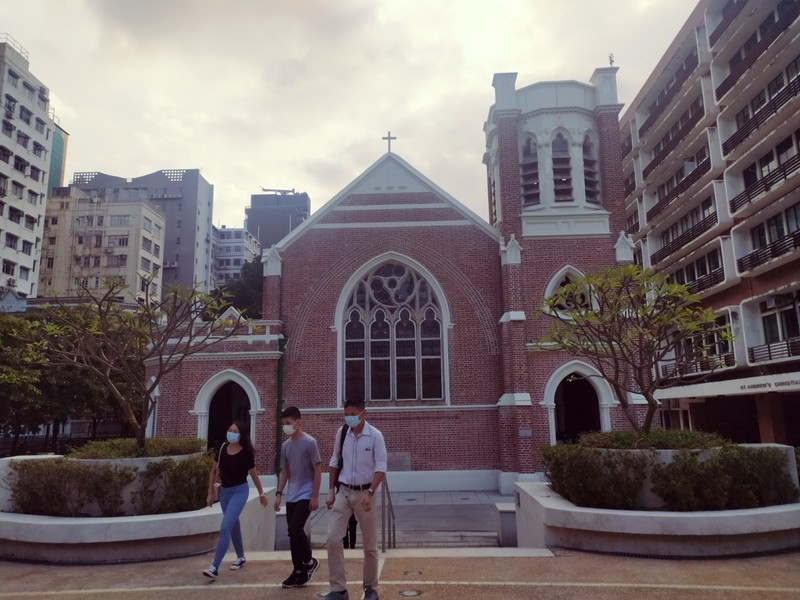Storm clouds gather behind Saint Andrew's Church, Kowloon.