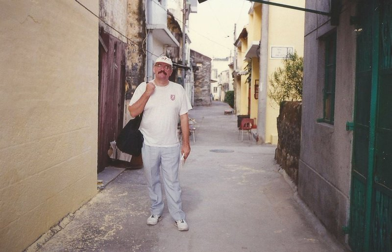 Peter wandering an old village street.