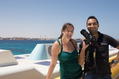 The girls told the boat photographer I was a photographer also so they felt like I should be in a photo with him.