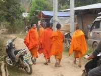 young monks leaving