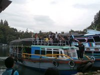Parapat harbour, school ferry arriving early morning