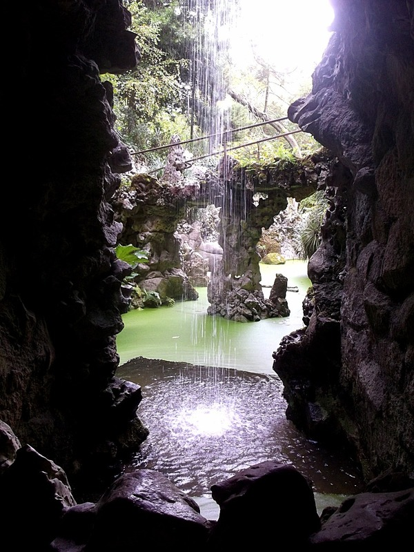 where tunnels lead to this waterfall grotto