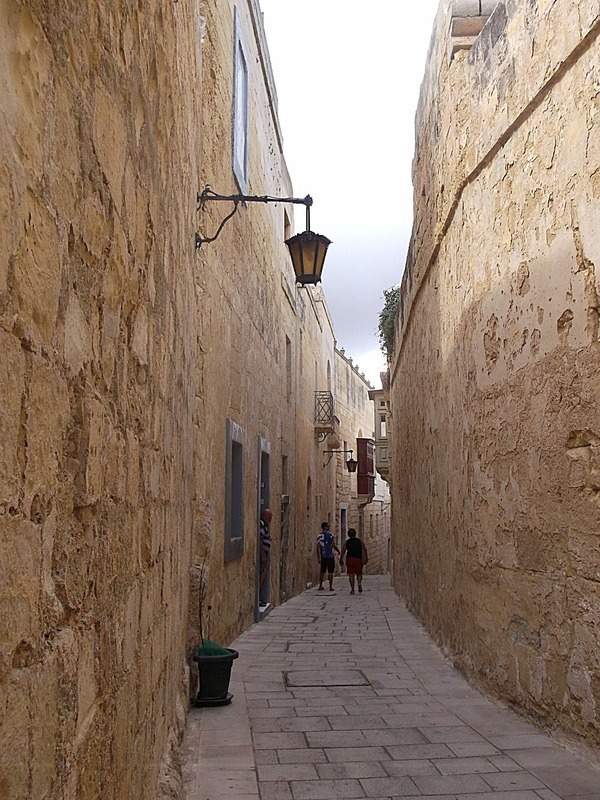 everyone gets to walk along narrow streets