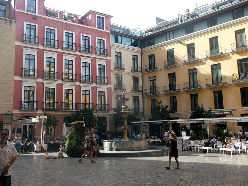 and the hotels and cafes across the square