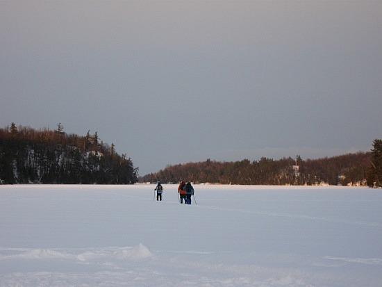 Skiiers on the lake