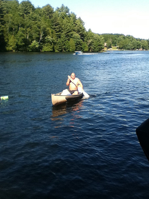 Shylo's uncle in a canoe