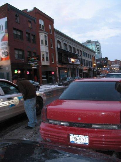 Guy breaking into a car