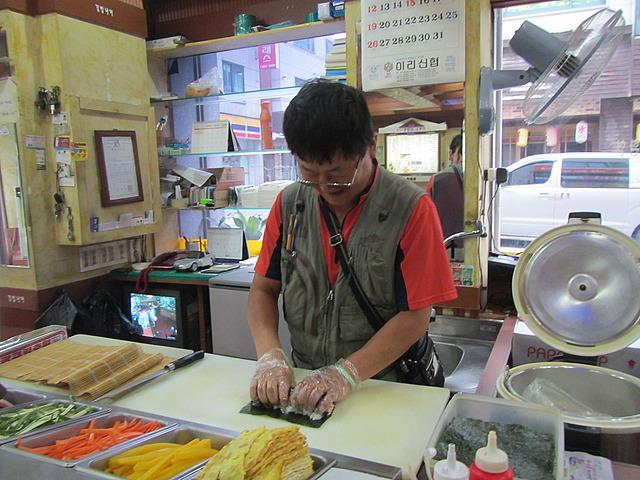 Guy making that sushi type stuff