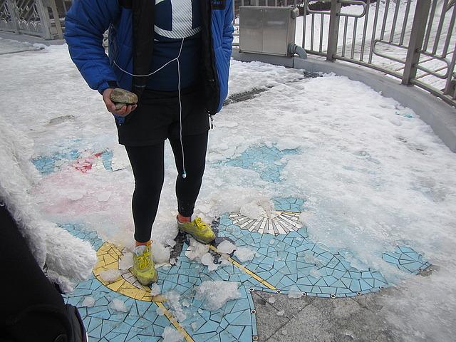 Jenna smashing the ice on the mosaic