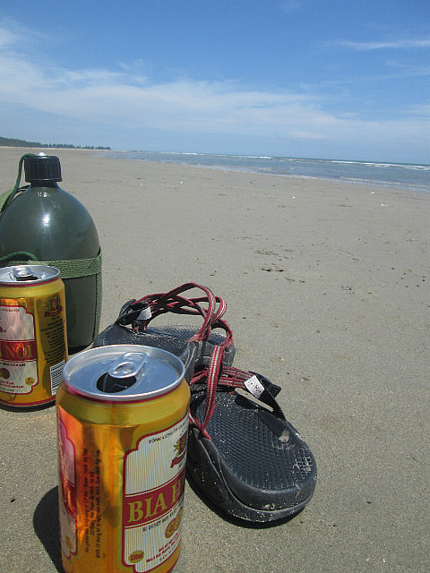 Beer, water, sandals, beach