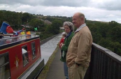 Bob and our daughter as boat passes
